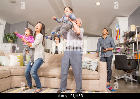 Three generation family having fun in sitting room - Stock Photo