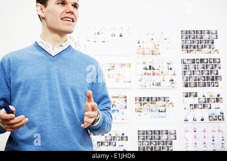 Young man in creative studio - Stock Photo