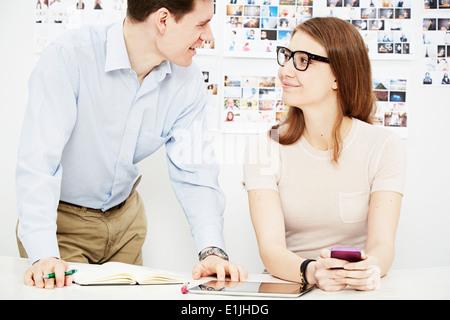 Two colleagues in creative studio - Stock Photo