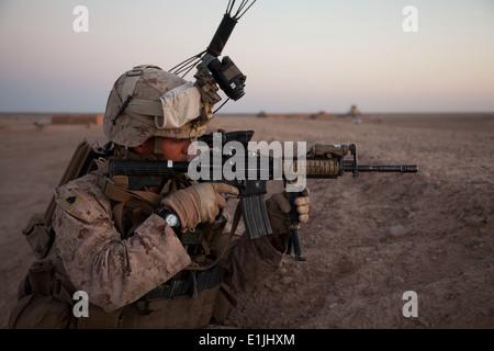 U.S. Marine Corps Sgt. Ryan Burks, a squad leader with Fox Company, 2nd Battalion, 8th Marine Regiment, Regimental - Stock Photo