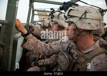 U.S. Navy Hospital Corpsman 3rd Class Bryan Doody, right, assigned to Fox Company, 2nd Battalion, 8th Marine Regiment, - Stock Photo