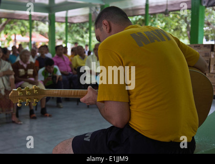 U.S. Navy Musician 1st Class Brian Nefferdorf, with the U.S. 7th Fleet Band, performs for residents at the Banglamung - Stock Photo