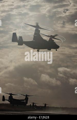Three U.S. Marine Corps MV-22B Osprey tiltrotor aircraft assigned to Marine Medium Tiltrotor Squadron (VMM) 265, - Stock Photo