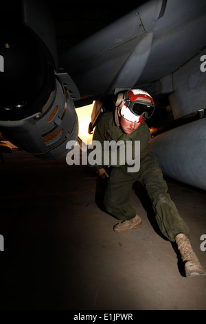 U.S. Marine Corps Lance Cpl. Tucker W. Edwards, an ordnance technician with Marine Attack Squadron (VMA) 311, inspects - Stock Photo