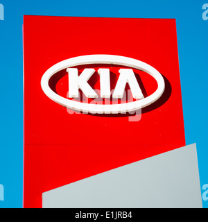 Kia motors sign at a car dealership, UK. - Stock Photo