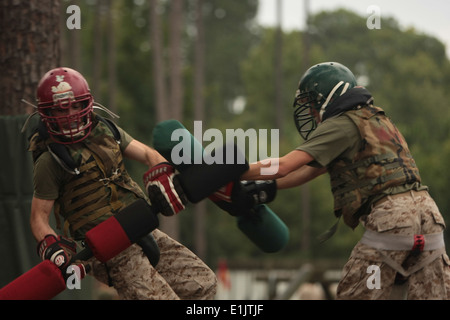 U.S. Marine recruits with Kilo Co., battle during pugil stick training at Parris Island, S.C., Sept. 17, 2013. Recruits - Stock Photo
