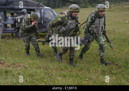 Portuguese soldiers with the 7th Portuguese National Contingency carry a simulated casualty from a U.S. Army UH - Stock Photo
