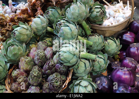 Organically grown Artichoke, Purple Aubergine and Garlic vegetables in the market stall - Stock Photo
