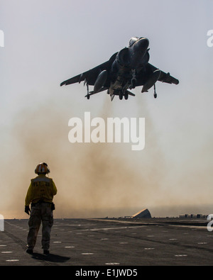 A U.S. Marine Corps AV-8B Harrier aircraft attached to Marine Medium Tiltrotor Squadron (VMM) 266, 26th Marine Expeditionary - Stock Photo