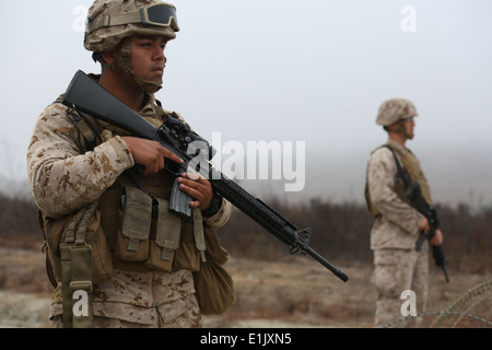 U.S. Marine Cpl. Ruben Guevara, with Landing Support Company, Combat Logistics Regiment 17, 1st Marine Logistics - Stock Photo