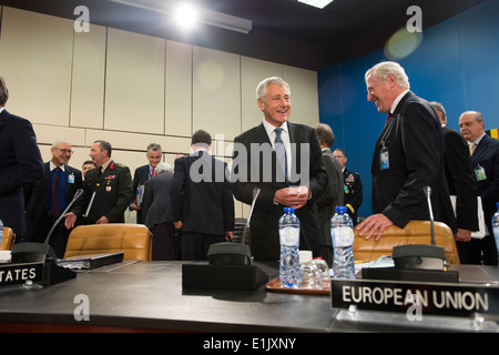 Secretary of Defense Chuck Hagel meets with foreign delegates during the North Atlantic Council meeting at the NATO - Stock Photo