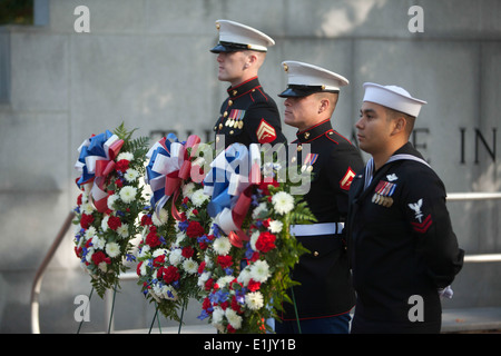 From left to right, U.S. Marine Corps Cpl. Gerrett Ogle, Lance Cpl. Stephen Carrera, and U.S. Navy Petty Officer - Stock Photo