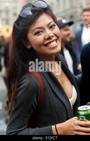Copenhagen, Denmark. 5th June 2014. Young woman ready for partying. She takes part in the giant party, which  rolls - Stock Photo
