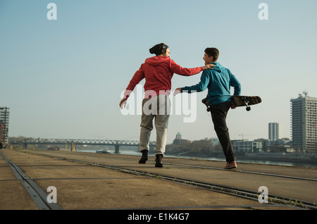 Young man and teenager with skateboard - Stock Photo