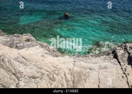 Rocky beach in Pula, Croatia, Adriatic sea. - Stock Photo