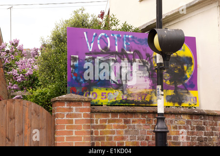 UKIP Election Poster vandalised by Graffiti in Framlingham, Suffolk,with signs on the houses adjacent reading 'Not - Stock Photo