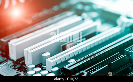 Printed circuit board with glowing red led light. - Stock Photo