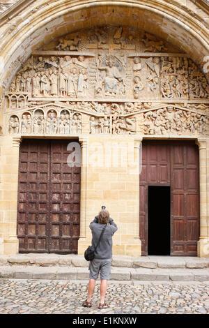Sainte Foy abbey church doors and tympanum - Stock Photo