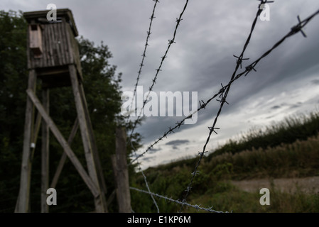 Barbed wire fence and lookout tower in POW camp  on display at Eden Camp Modern History Theme Museum England - Stock Photo