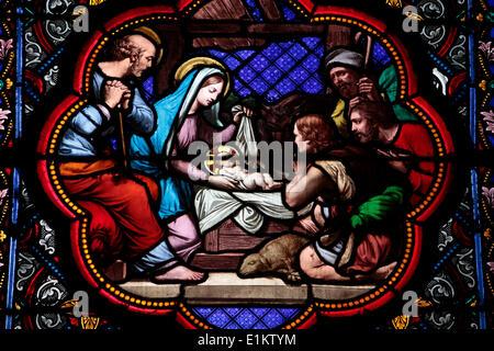 Nativity stained glass in Sainte Clotilde church - Stock Photo