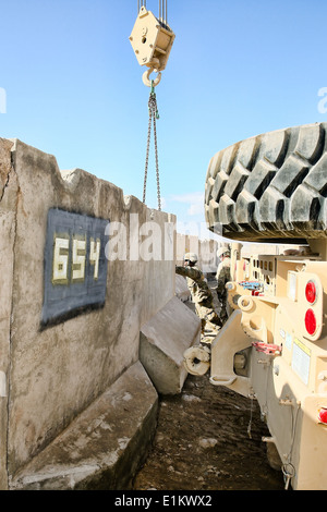 U.S. Soldiers with the 124th Engineer Company, South Carolina Army National Guard move blast-resistant concrete - Stock Photo