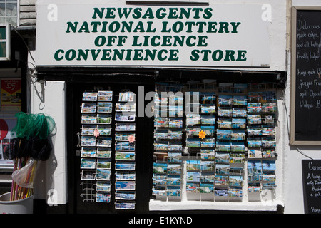 Post cards on the pavement out side a gifts shop in the cornish seaside town of Mevagissey - Stock Photo