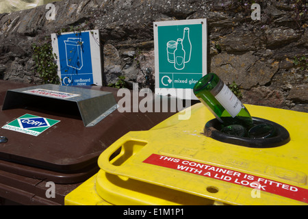 Coloured Recycling Bins in quayside in the cornish seaside village of Mevagissey - Stock Photo