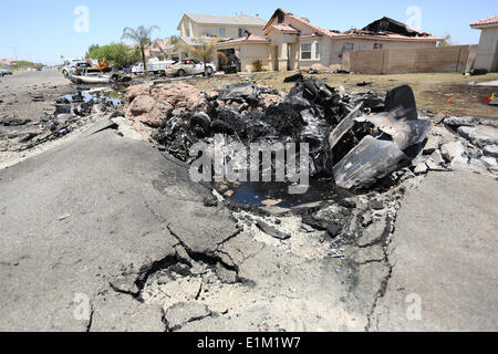 Remains of a US Marine Corps AV-8B Harrier fighter aircraft that crashed in a housing development June 5, 2014 in Imperial, California. Eight homes were evacuated with three destroyed but no injuries reported. Stock Photo