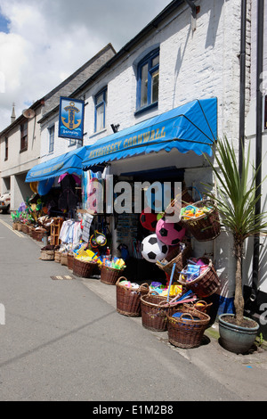 Goods on the pavement out side a tourist gifts shop in the cornish seaside town of Mevagissey - Stock Photo