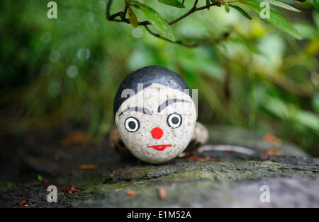Painted stone used in shamanist rituals - Stock Photo