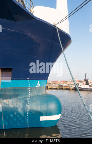 Bow of big ship in harbor of Urk, the Netherlands - Stock Photo