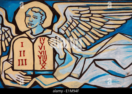 Painting in Our Lady of Togo church : Angel holding the tables of the law - Stock Photo