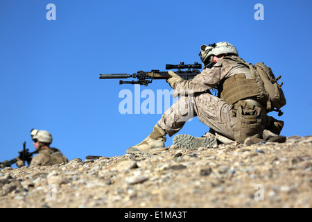 U.S. Marines with Charlie Company, 1st Battalion, 9th Marine Regiment provide security during a patrol near Patrol - Stock Photo