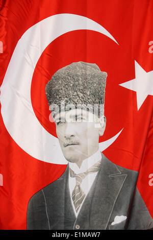 Turkish flag with a portrait of Ataturk. - Stock Photo