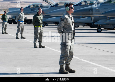U.S. Air Force crew chiefs with the 140th Aircraft Maintenance Squadron, Colorado Air National Guard wait for the - Stock Photo