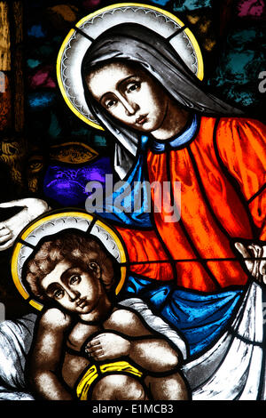 Stained glass window in St Mary's church : Virgin and child - Stock Photo