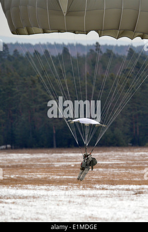 A U.S. Army Paratrooper assigned to 173rd Infantry Brigade Combat Team (Airborne) conducts a training jump from - Stock Photo