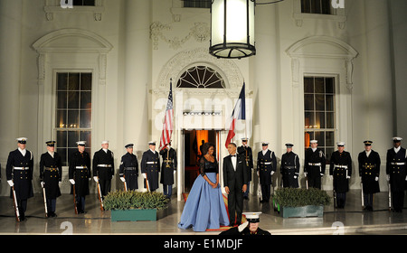 President Barack H. Obama, center right, and first lady Michelle Obama, center left, wait for French President Francois - Stock Photo
