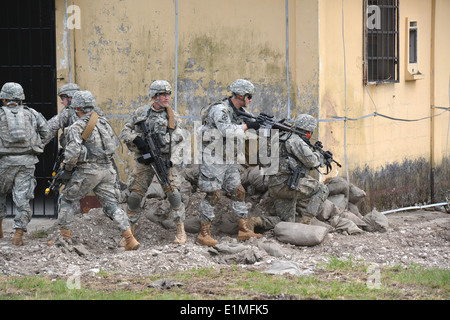 U.S. Soldiers assigned as paratroopers to Charlie Company, 2nd Battalion, 503rd Infantry Regiment, 173rd Airborne - Stock Photo