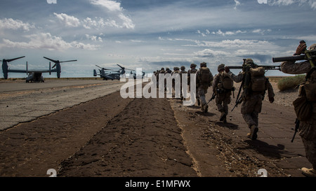 U.S. Marines with the 3rd Battalion, 6th Marine Regiment, 2nd Marine Division board MV-22 Osprey tiltrotor aircraft at Auxiliar