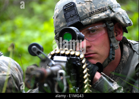 U.S. Army Pfc. Darren P. Ziolkowski, a paratrooper with Bravo Company, 2nd Battalion, 503rd Infantry Regiment, 173rd - Stock Photo