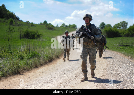 U.S. Army Staff Sgt. Nathan A. Harrison, front, and fellow paratroopers assigned to Battle Company, 2nd Battalion, - Stock Photo