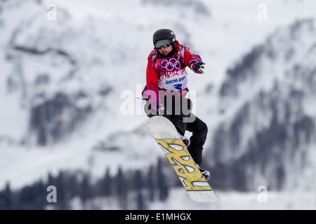 Sina Candrian (SWI) competing in Ladies's Snowboard Slopestyle at the Olympic Winter Games, Sochi 2014 - Stock Photo