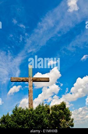 Crucifix against blue sky - Stock Photo