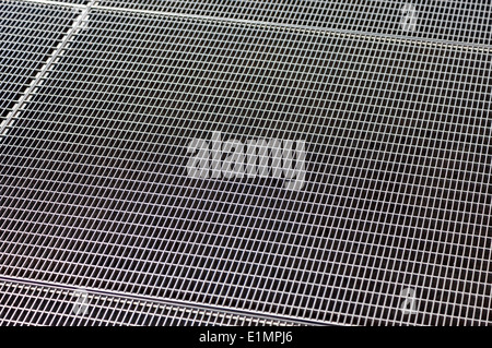 Metal grill texture with holes as background - Stock Photo