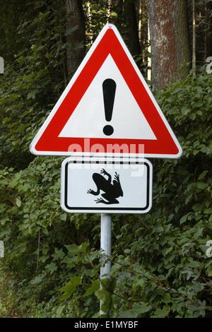 Traffic sign Frog Crossing in the Moravian Karst (Moravsky Kras) Area near Brno, Czech Republic. - Stock Photo