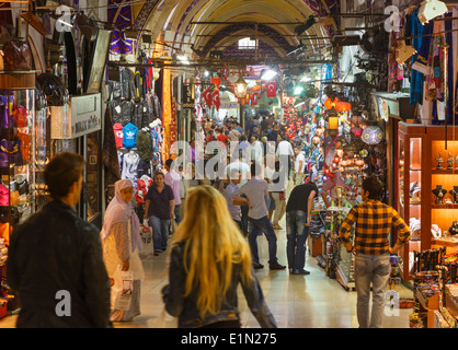 Istanbul, Turkey. Shopping in a passageway of the Kapali Carsi, the Grand Bazaar. - Stock Photo