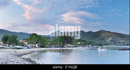 Katelios Harbour, Kefalonia in the evening as the sun sets casting pink clouds in the sky. - Stock Photo