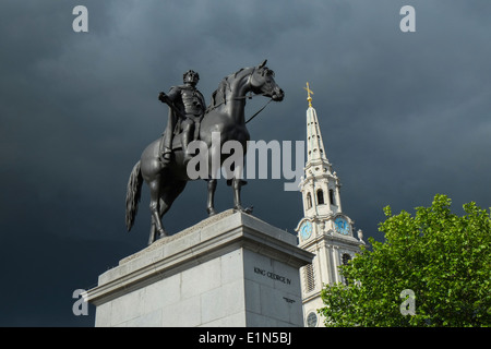 King George IV statue Trafalgar Square with Storm Clouds - Stock Photo