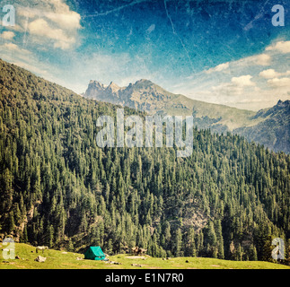 Vintage retro hipster style travel image of camp tent in Himalayas mountains with overlaid grunge texture - Stock Photo
